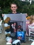 Bill's Grandson walked around the table showing the photo of Bill give his buddy the ugly jacket.
