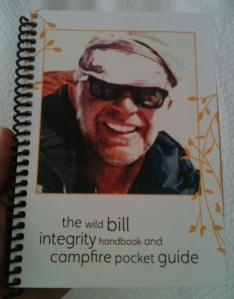 """A book handed out to guests, """"The Wild Bill Integrity Handbook and Campfire Pocket Guide"""""""