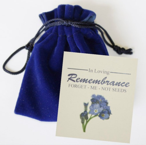 Memorial seed pouches with forget-me-not flower seeds