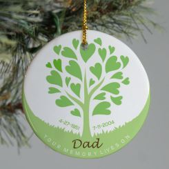 Green and white ceramic ornament with tree and hearts