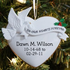 White heart shaped ornament with dove and holly sprig