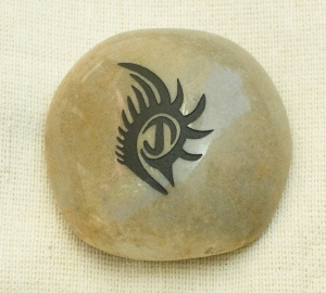 A stone with the graphic of your loved one's tattoo. Perfect everlasting keepsake.