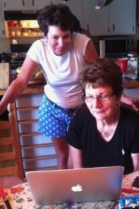 Women attending funeral online